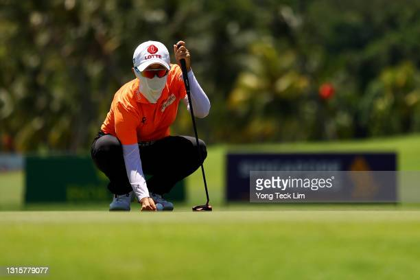 Hyo Joo Kim of South Korea lines up her putt on the 16th green during the final round of the HSBC Women's World Championship at Sentosa Golf Club on...