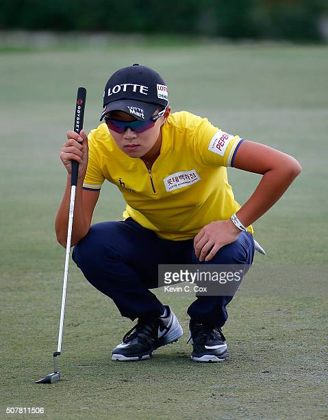 Hyo Joo Kim of South Korea lines up her putt on the 16th green during the final round of the Pure Silk Bahamas LPGA Classic at the Ocean Club Golf...