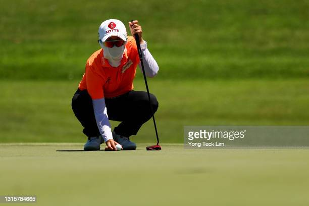 Hyo Joo Kim of South Korea lines up her putt on the 18th green during the final round of the HSBC Women's World Championship at Sentosa Golf Club on...