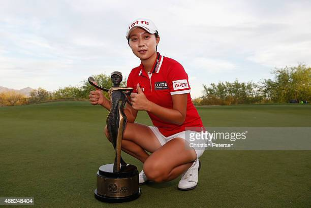 Hyo Joo Kim of South Korea poses with the LPGA Founders Cup trophy after winning in the final round at Wildfire Golf Club on March 22 2015 in Phoenix...