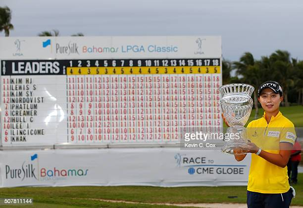 Hyo Joo Kim of South Korea poses with the trophy after the final round of the Pure Silk Bahamas LPGA Classic at the Ocean Club Golf Course on January...