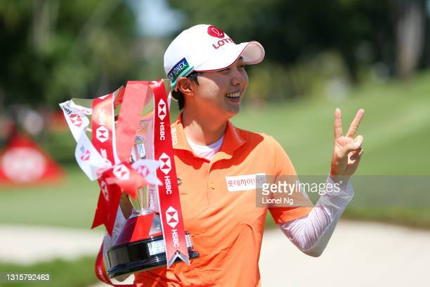 Hyo Joo Kim of South Korea poses with the trophy after winning the tournament following the final round of the HSBC Women's World Championship at...
