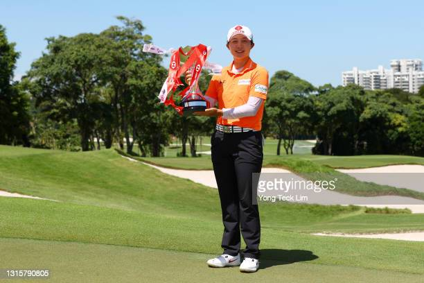 Hyo Joo Kim of South Korea poses with the winner's trophy after winning the HSBC Women's World Championship at Sentosa Golf Club on May 02, 2021 in...