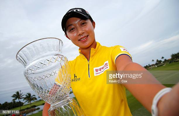 Hyo Joo Kim of South Korea pretends to take a selfie as she poses with the trophy after the final round of the Pure Silk Bahamas LPGA Classic at the...