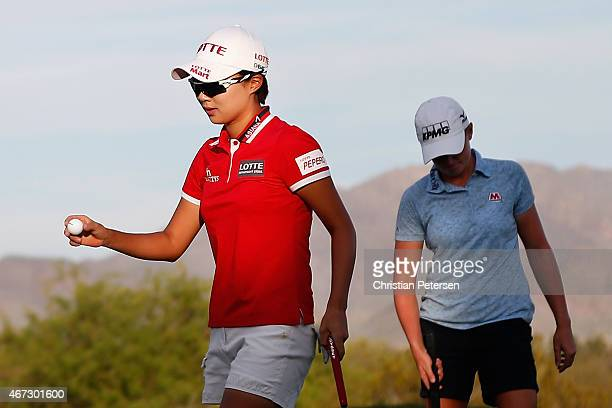 Hyo Joo Kim of South Korea reacts after a birdie putt on the 18th green, alongside Stacy Lewis, to win the LPGA Founders Cup at Wildfire Golf Club on...