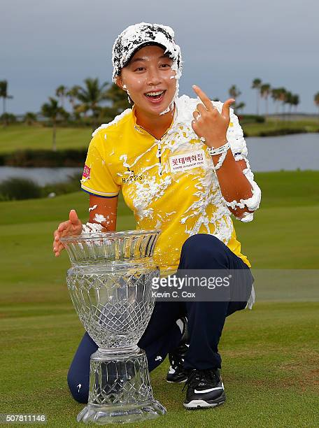 Hyo Joo Kim of South Korea reacts after being sprayed with Pure Silk shave cream after winning the Pure Silk Bahamas LPGA Classic at the Ocean Club...
