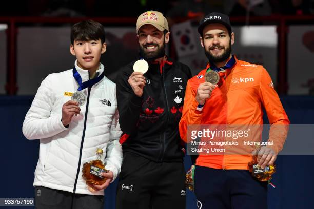 Hyo Jun Lim of Korea Charles Hamelin of Canada and Sjinkie Knegt of the Netherlands hold up their medals after competing in the men's 1000 meter...