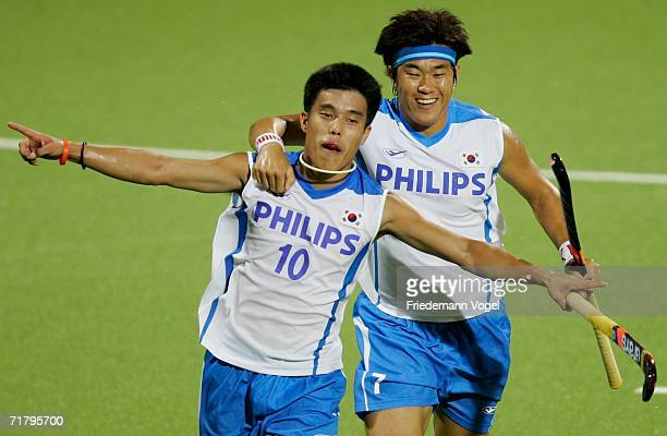 Hyo Sik You celebrates scoring the first goal with Jong Ho Seo of Korea during the World Cup Pool B match between Korea and Netherlands at the...