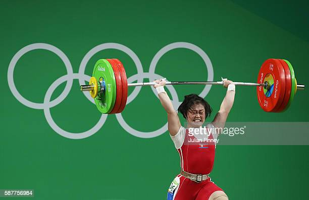 Hyo Sim Choe of Korea lifts for an Olympic record during the Women's 63kg Group A Weightlifting contest on Day 4 of the Rio 2016 Olympic Games at the...