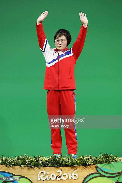 Hyo Sim Choe of the Republic of Korea celebrates after winning the silver medal during the Women's 63kg Group A Weightlifting contest on Day 4 of the...