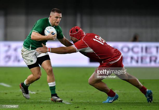 Hyogo Japan 3 October 2019 Andrew Conway of Ireland is tackled by Denis Simplikevich of Russia during the 2019 Rugby World Cup Pool A match between...