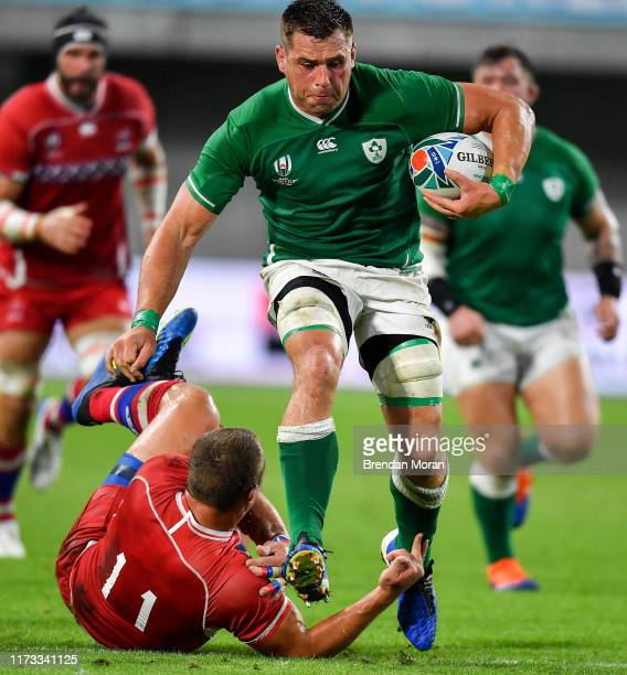 Hyogo Japan 3 October 2019 CJ Stander of Ireland beats the tackle of Denis Simplikevich of Russia during the 2019 Rugby World Cup Pool A match...