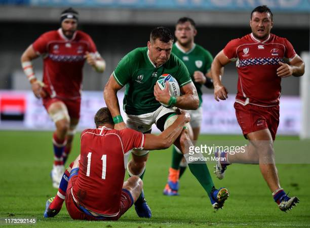 Hyogo Japan 3 October 2019 CJ Stander of Ireland is tackled by Denis Simplikevich of Russia during the 2019 Rugby World Cup Pool A match between...