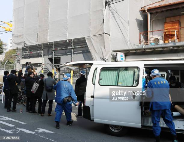 Hyogo prefectural police are pictured at the scene as they investigate an apartment where a decapitated head was found in Osaka on February 25 2018...