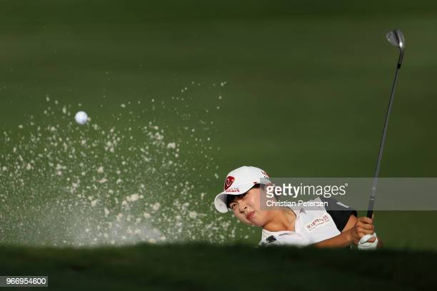 HyoJoo Kim of South Korea chips from the bunker on the second playoff hole during the final round of the 2018 US Women's Open at Shoal Creek on June...