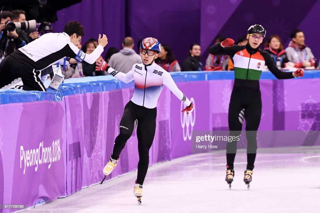 Hyojun Lim of Korea celebrates with his coach after an Olympic record as Shaolin Sandor Liu of Hungary looks on during the Men's 5000m Relay Short Track Speed Skating heat 2 on day four of the PyeongChang 2018 Winter Olympic Games at Gangneung Ice Arena on February 13, 2018 in Gangneung, South Korea.