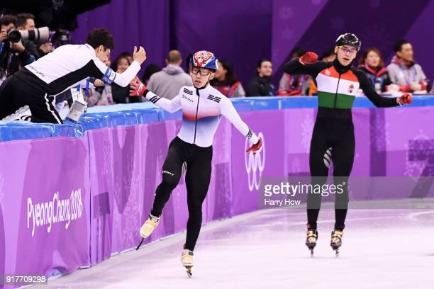 Hyojun Lim of Korea celebrates with his coach after an Olympic record as Shaolin Sandor Liu of Hungary looks on during the Men's 5000m Relay Short...