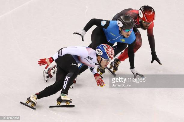 Hyojun Lim of Korea Denis Nikisha of Kazakhstan and Charles Hamelin of Canada compete during the Men's Short Track Speed Skating 500m Heats on day...