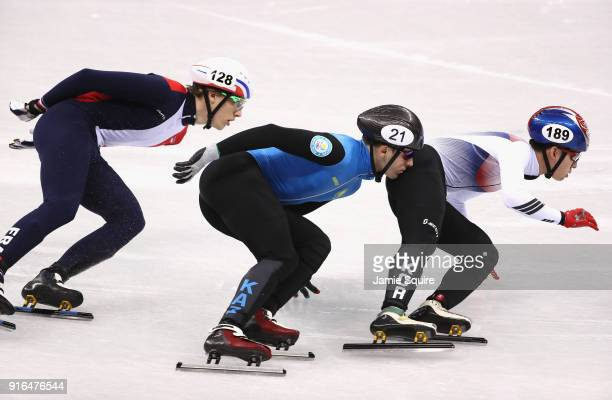 Hyojun Lim of Korea Denis Nikisha of Kazakhstan and Sebastien Lepape of France compete during the Men's 1500m Short Track Speed Skating qualifying on...