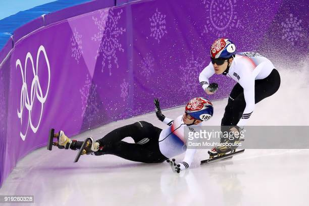 Hyojun Lim of Korea falls as Yira Seo of Korea skates past during the Short Track Speed Skating Men's 1000m Final A on day eight of the PyeongChang...
