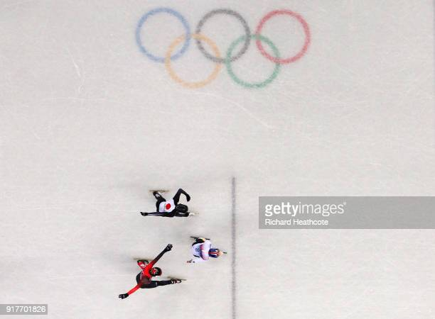 Hyojun Lim of Korea Kazuki Yoshinaga of Japan and Charle Cournoyer of Canada race towards the finish line during the Men's 1000m Short Track Speed...