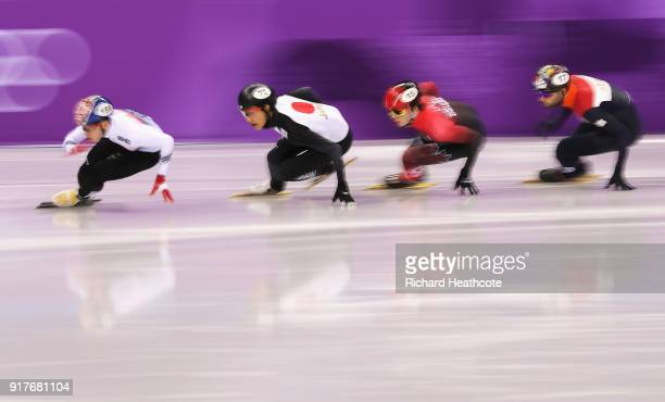 Hyojun Lim of Korea Kazuki Yoshinaga of Japan Charle Cournoyer of Canada and Daan Breeuwsma of the Netherlands compete during the Men's 1000m Short...