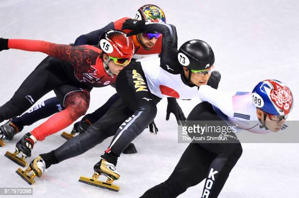 Hyojun Lim of Korea Kazuki Yoshinaga of Japan Charle Cournoyer of Canada and Daan Breeuwsma of the Netherlands compete during the Men's 1000m Short...