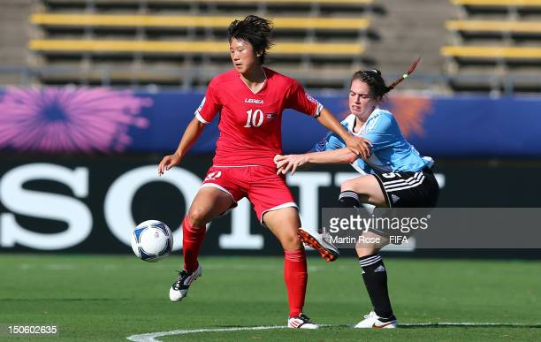 Hyon Hi Yun of Korea DPR and Camila Gomez Ares of Argentina battle for the ball during the FIFA U20 Women's World Cup 2012 group C match between...