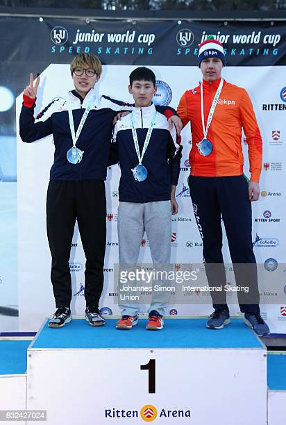 Hyon Min Oh and Hae Yeong Lee of Korea and Bart Hoolwerf of the Netherlands pose during the medal ceremony after winning the men's junior mass start...