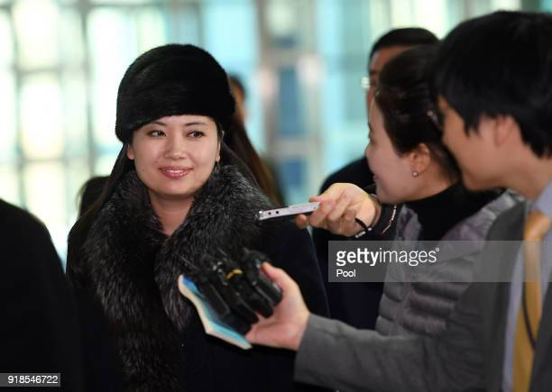 Hyon Song Wol a leader of North Korea's Samjiyon Orchestra arrives at the interKorea transit office in Paju near the Demilitarized zone to leave for...