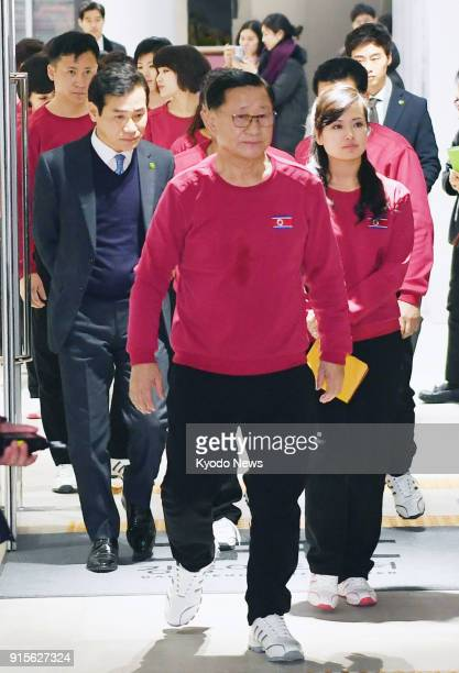 Hyon Song Wol head of North Korea's Samjiyon art troupe and other members leave a concert hall in Gangneung South Korea on Feb 7 after practicing for...