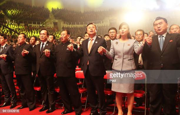 Hyon Songwol head of the North Korea's Samjiyon Orchestra South Korean Culture Sports and Tourism Minister Do JongWhan and Kim Yong Chol vice...