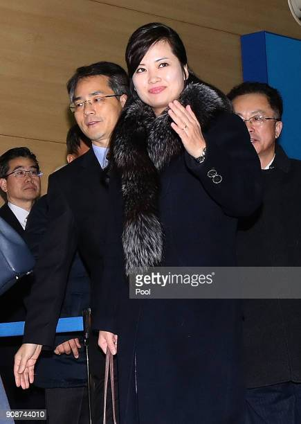 Hyon Songwol head of the North Korea's Samjiyon Orchestra waves as she arrives at the customs immigration and quarantine office for departure to...