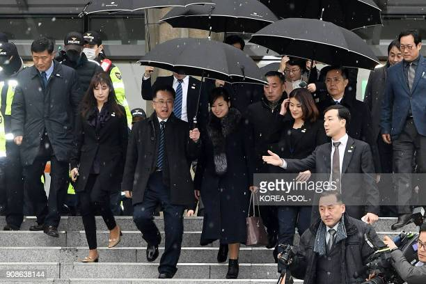 Hyon SongWol leader of North Korea's popular Moranbong band leaves after she inspected the Korea National Theater for planned musical concerts during...