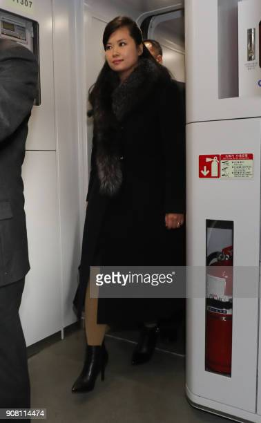 Hyon SongWol the leader of North Korea's popular Moranbong band boards a train bound for the eastern city of Gangneung at Seoul station in Seoul on...