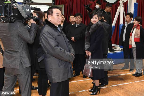 HyonSongWol a North Korean pop star party member and head of an advance team for North Koreas art troupe center right checks a performance venue...