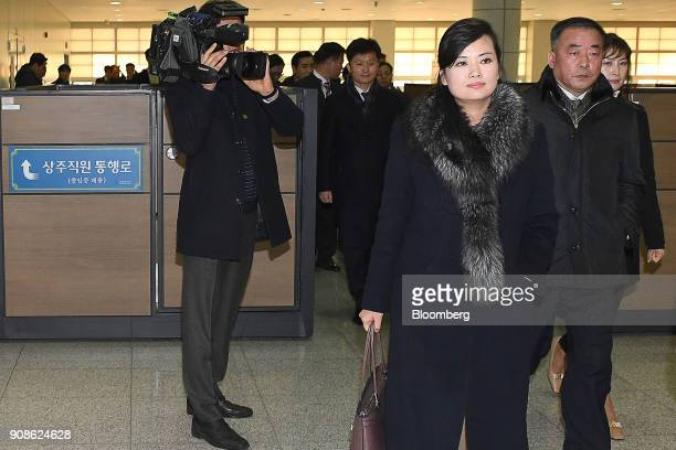HyonSongWol a North Korean pop star party member and head of an advance team for North Koreas art troupe center right walks through the customs...