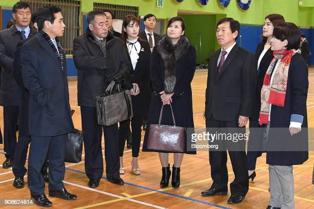 HyonSongWol North Korean pop star and head of advance team for North Koreas art troupe center right checks a performance venue for the 2018...