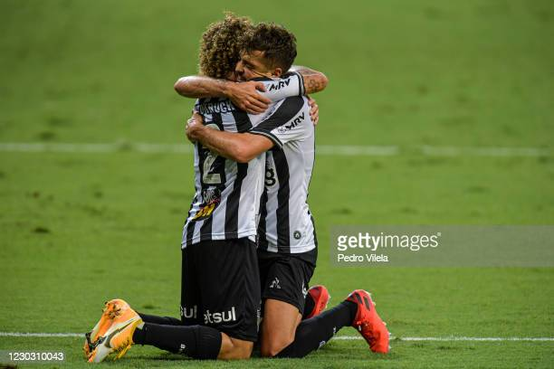 Hyoran of Atletico MG celebrates with Guga after scoring the first goal of their team during a match between Atletico MG and Coritiba as part of...