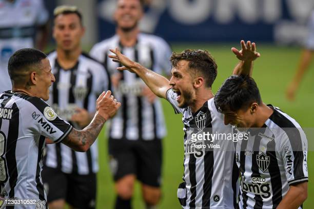 Hyoran of Atletico MG celebrates with teammates after scoring the first goal of their team during a match between Atletico MG and Coritiba as part of...