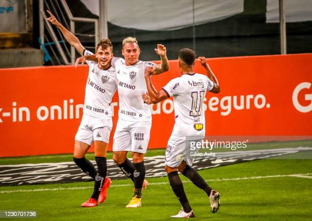 Hyoran of Atletico Mineiro celebrates with his teammates after scoring the first goal of their team during the match against Gremio as part of...