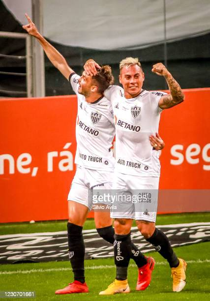 Hyoran of Atletico Mineiro celebrates with teammate after scoring the first goal of their team during the match against Gremio as part of Brasileirao...