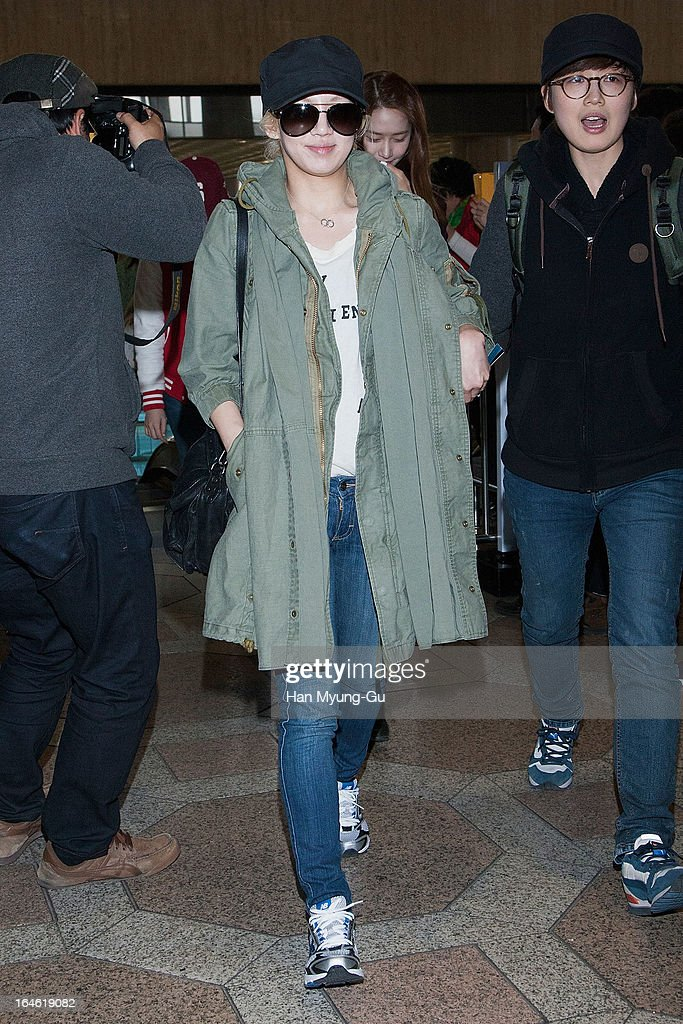 Hyoyeon of South Korean girl group Girls' Generation is seen on departure to Japan at Gimpo International Airport on March 25, 2013 in Seoul, South Korea.