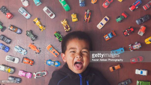 Hyperactive Kid With Cars.
