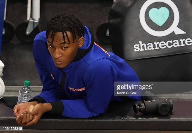 Hyperice Hypervolt is seen next to Immanuel Quickley of the New York Knicks during the second half against the Atlanta Hawks at State Farm Arena on...