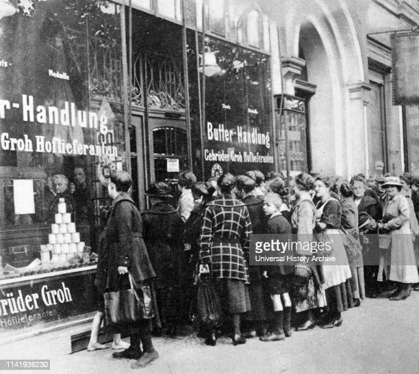 Hyperinflation in Weimar Germany 1923 Queues for groceries in Berlin as the value of the German Reichsmark spirals out of control and becomes...