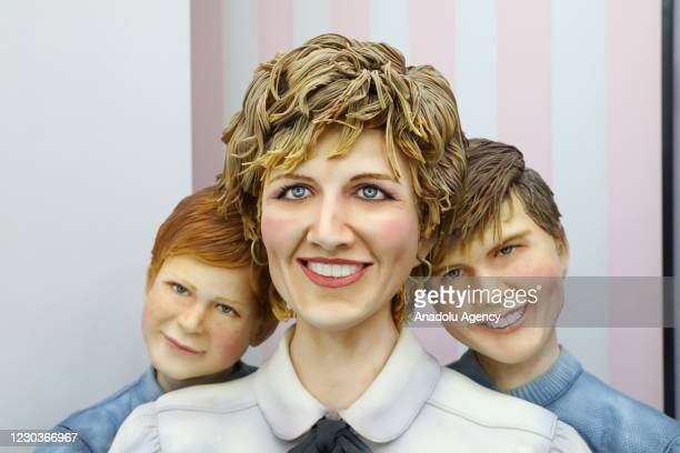 Hyper-realistic cake figures of a woman and children made by Tuba Geckil, a self-described cake & sugar artist, in Istanbul, Turkey on December 25,...