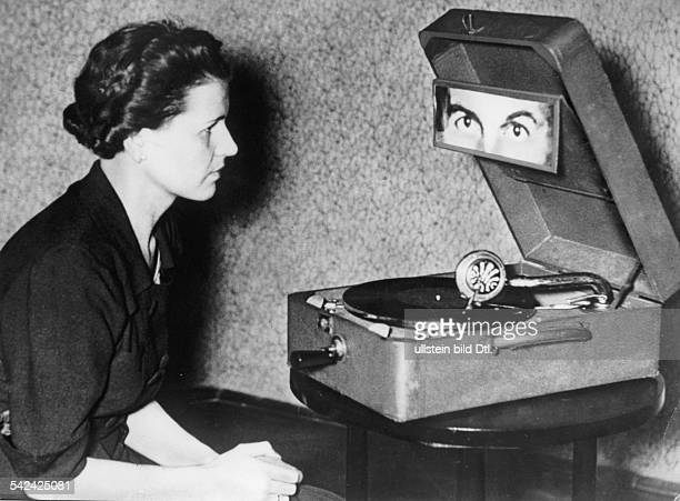 Hypnotism Telepathic hypnosis by means of a gramophone the female subject has to concentrate on the photograph of her eyes while a record is being...