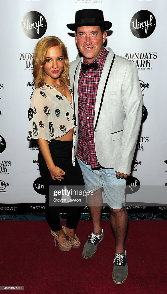 Hypnotist Anthony Cools (R) and Morea Reveen arrive at 'Mondays Dark With Mark Shunock' benefiting the NF Network at Vinyl inside the Hard Rock Hotel & Casino on May 19, 2014 in Las Vegas, Nevada.