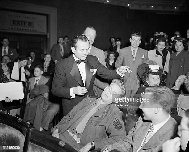 Hypnotist Ralph Staten demonstrates his abilities Photograph 1946